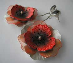 Earrings on a stick made from silver 930, leather and organza. Poppy flowers hand-painted on the skin, decorated with shimmering organza and decorative veins. Silver hammered, frosted.