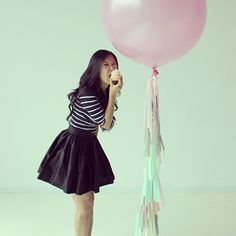"""""""@_amycheung_ in her black #partyskirt and one of her AMAZING fancy frill balloons   #partyskirts #skotapparel #fancyfrill #balloons"""""""