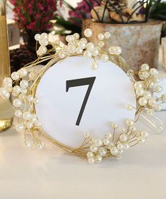 This elegant Wire and Pearl Ring is not only suited for use as a candle decoration but also makes a unique frame for table numbers, photos or signs.