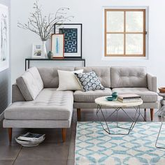 Traditional meets modern. The Peggy Mid-Century Terminal Chaise Sectional combines clean, classic lines with retro details, like tufted back and seat cushions and tapering pecan-stained solid wood legs.
