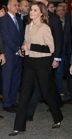 17 January 2018 - King Felipe and Queen Letizia attend the opening of Fitur 2018 in Madrid - jacket by Hugo Boss, shoes by Uterque