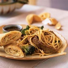 Beef-Broccoli Asian noodles -- seriously one of our favorites, spicy!  Changes: dice onion, and cook first and longer to make more caramelized and tender.  Use 1 Tbsp regular soy sauce, 2 Tbsp low-sodium; use half the amount of sugar listed. ALWAYS use linguini rather than spaghetti (holds sauce better), and NEVER use bottled garlic or ginger (trust me).  Easily made into great vegetarian dish.