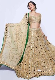 Janhvi Kapoor dazzled in an all gold lehenga choli beautifully hand-crafted with mirrors by Abu Jani & Sandeep Khosla. Gold Lehenga, Bridal Lehenga, Lehenga Choli, Anarkali, Sarees, Lehenga Wedding, Lehenga Designs, Indian Wedding Outfits, Indian Outfits