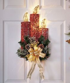 Greet your guests with something different this year and hang this Lighted Holiday Candle Decor on your door.