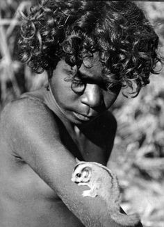 A young lubra - Nalilli with sugar glider - photo taken by Charles P. Mountford on an anthropological expedition to Central Australia in the 1950's.