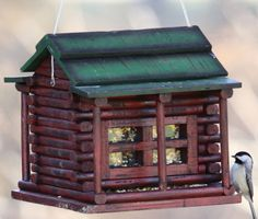 Wood Log Cabin Bird Feeder. This classic looking rustic bird feeder is all wood, hand painted with a beautiful weathered look. Lovely little cabin windows give handy viewing access to seed levels. Roof opens up for easy filling and cleaning.