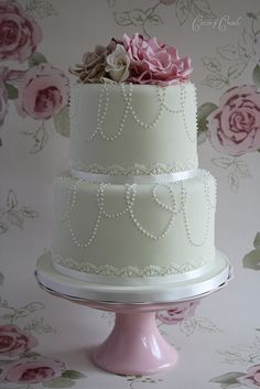 not the color of this cake, but doing  little white/ivory pearls that would correspond with your necklace...cool!