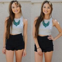 Blogger Yvonne (@everydayyvonne via Instagram) looks lovely in a jade statement necklace, crop top, and high waisted shorts from Charlotte Russe!
