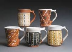 The simple lines and dots on these mugs were made with a slip trailer.