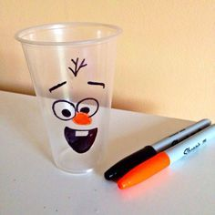 I bought plastic cups and used a black and orange sharpie to draw an OLAF! We love this idea for a Frozen Party. So many Frozen party ideas at www.myprincesspartytogo.com