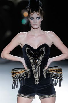 For the corset 'Edelweiss' Maya Hansen focused on fully transparent crystals to give an ice finishing and texture to the silvery fabric that accompanies the look. Description from crystalblog.com. I searched for this on bing.com/images