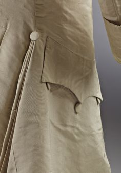 Detail of a jacket pocket, 3-piece wedding suit, 18th century. Cream silk. (costume collection at Ham House, Surrey)