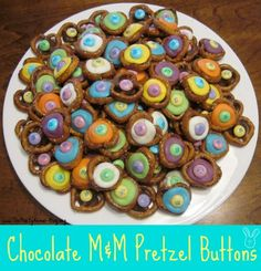 Chocolate M pretzel buttons. Mini pretzels, candy wafers & M's. melt candy wafer on top of pretzel in preheated 350 oven - chocolate wafers for 2 minutes & colored & vanilla wafers for 3 minutes. Top with M while wafers are still warm. YUM!