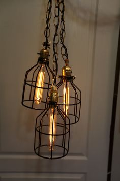 Set of 3 Industrial Wire Cage Lamps/ Hanging Lights. $120.00, via Etsy.