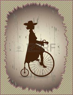 Senhora bonita em um vestido e chap�u montando uma bicicleta do vintage photo