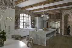 Modern rustic kitchen - introducing white cabinets, chandeliers with beams Mixing textures