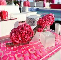 centerpieces ideas high heels   ... . The centerpieces were high heels and purses with pink flowers