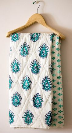 Reversible handmade block print quilt for babies and toddlers.