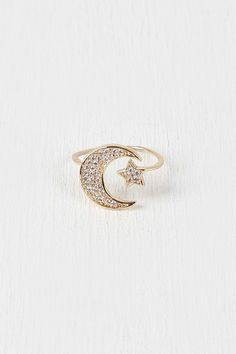 Rhinestone Moon and Star Ring - Gold Description An open-ended  ring  featuring rhinestone-encrusted moon and star designs at ends, glossy enamel, and non-adjustable band.  Measurement Measures approx. 0.75  D. UNG58789GLD   http://p.nembol.com/p/4J5GxG_H6l Published via Nembol app