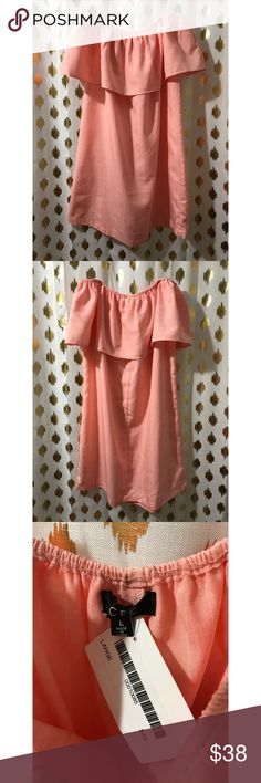 Peachy colored OTS dress Peachy colored off the shoulder dress with pin stripe detailing. Size Large, but there is no stretch in the body of this dress, just at the top in the shoulder area! Price is firm since it is brand new court and layne Dresses