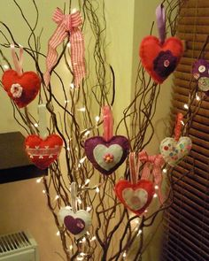 To create a Valentine's Day tree, princesssleepalot made little felt hearts adorned with different embellishments and hung them from twig lights on display in a front hallway. To see more of princesssleepalot's creations,  visit her blog.