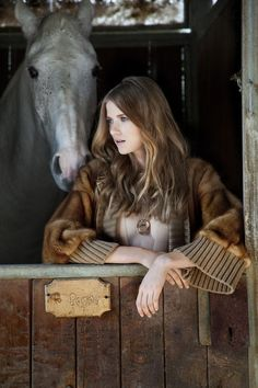 Cowgirl with her horse in barn  #cowgirl #countrygirl #cowgirllifestyle  http://www.islandcowgirl.com/