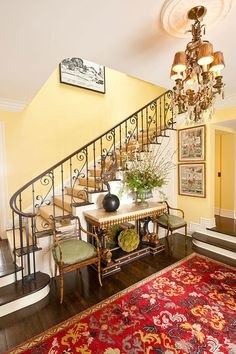 Pale yellow counterbalances w the heavy gilded chandelier, marble console, and red wool rug, beautiful wrought iron stair rail. Pale Yellow Paints, Yellow Painting, Yellow Walls, Mellow Yellow, Yellow Stairs, White Walls, Farrow Ball, Wrought Iron Stair Railing, Iron Railings