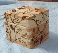 """Wood burnt design on box. A very fine example of """"going round the corners & over the top"""" using the same design. This design technique gives the wooden box an organic & harmonius element that softens the hard edges. Not quite so easy to do but the results are very pleasing ;)"""