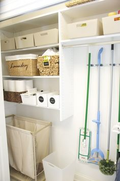 """Open laundry room """"closet"""". Love the idea of hanging your brooms/swiffers/mops."""