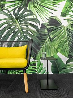 Colorful Office Renovation by Ghislaine Viñas. Tropical leaf wallpaper and bright yellow couch cushions add an unconventional feel to this office space.