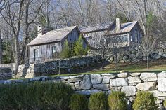 """This weekend house was designed with local stone and wood to maximize the expression of a typical country """"cottage."""" The owners required a modern residence that would blend in with the character of its Connecticut wooded area context."""
