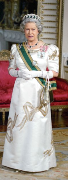 HM Queen Elizabeth II wearing the Delhi Durbar (or Cambridge emeralds) necklace, earrings and brooch, along with the emerald version of the Grand Duchess Vladimir tiara.