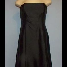 Stunning Silk Cocktail Dress Gorgeous little black dress from Ann Taylor. Dress is strapless with side zip. Has center folded-pleats with bow and attachable black straps for your comfort level. 100% silk shell and fully lined in 100% acetate. Brand new with tags! Ann Taylor Dresses Strapless