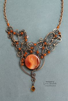 Wire necklace ♥ by Schepotkina Middle reddish gemstone looks like the one I got with Topher Wire Jewelry Designs, Metal Jewelry, Jewelry Crafts, Jewelry Art, Beaded Jewelry, Jewellery, Big Jewelry, Bijoux Wire Wrap, Wire Wrapped Jewelry