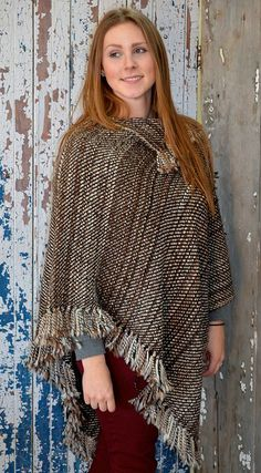 Handwoven alpaca poncho from Legacy Lane Fiber Mill...you can buy these online or get this company to make you one from your own yarn...better yet, they'll take your raw fiber, make it into yarn and THEN weave it for you!!