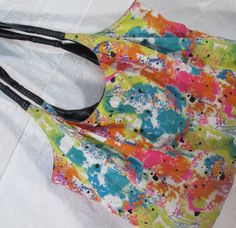 There are no exterior pockets and there is one zippered interior pocket. Entry to the bag is protected by a single magnetic snap at the center of the bag opening. There is a reinforced bottom section sewn into the inside of the canvas shell. Splatter Paint Canvas, Painted Canvas, Velcro Wallet, Canvas Purse, Finding Joy, Key Card Holder, Clutch Wallet, Paisley Print