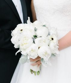 Chic white peony wedding bouquet; photo: Michelle Lange Photography