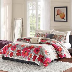 The Kendal Comforter and Decorative Pillows set provides a fresh and cheerful look for your bedroom. The Comforter and sham (s) feature a contemporary multi color floral pattern in red, pink, orange, taupe and grey colors mixed with a geometric pattern in neutral colors of ivory and taupe. The oblong pillow features an solid ivory color pleated and accented with grey stripes on the sides. The square pillow features a solid grey color pleated with red accent vertical stripe details.