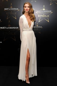Rosie Huntington-Whiteley attends the Moet & Chandon Etoile award ceremony to honour Mario Testino for his contribution to cultural society at Park Lane Hotel on September 19, 2011 in London, England.