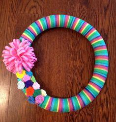 Shades of Rainbow Wreath, yarn wrapped wreath with felt flowers. $20.00, via Etsy.