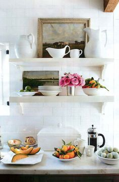 open shelving kitchen. white plateware. flowers. art. i want this kitchen!