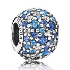 PANDORA's popular multicolor pavé charm is now available in calm shades of blue and white - a dazzling addition to any bracelet.  Crafted from sterling silver and featuring 78 hand-set crystal and cubic zirconia stones, this artistic charm is a true representation of PANDORA's outstanding craftsmanship.<br> <b> Style</b>791261NSBMX