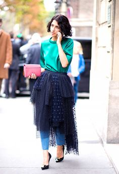 Tulle skirt worn over cropped jeans and black pumps