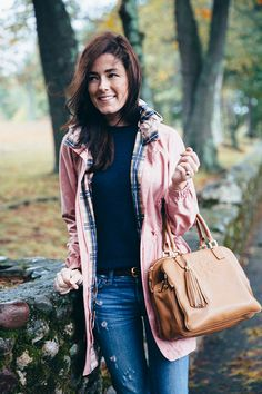 Blogger Classy Girls Wear Pearls looking great in a Tory Burch anorak and tote
