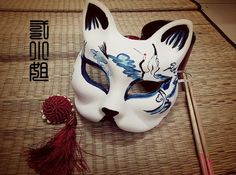 This is a modern artists take on kabuki masks  (imgarcade.com/1/japanese-fox-festival-mask, 2014)