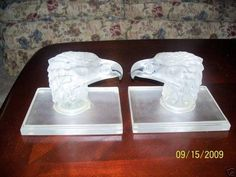 Eagles head mascots as a pair of bookends on signed Lalique glass bases.