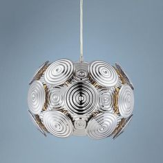 This sculptural design from the Possini Euro Design lighting collection features round molded panels in dramatic chrome finish. wide x 9 high x canopy is 4 wide x hanging weight is lbs. Style # at Lamps Plus. Cool Light Fixtures, Ceramic Table Lamps, Circle Pattern, Pendant Chandelier, Sconce Lighting, Mini Pendant, Hanging Lights, Glass Pendants, Euro