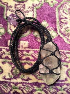 Black Cord Wrapped Healing Crystal Necklace- Quartz Point - Clarity, Balance, All-Purpose Healer. $30.00, via Etsy.