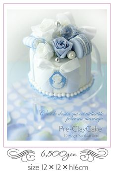 Blue & white cameo with pearls, roses, & pearls  #cake