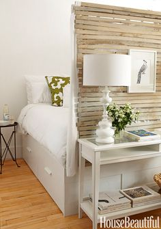 In a 400-square-foot Brooklyn apartment designed by Fitzhugh Karol and Lyndsay Caleo of The Brooklyn Home Company, Ikea's Brimnes bed has drawers underneath, for more storage. - HouseBeautiful.com
